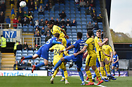 Oxford United defender Curtis Nelson (5) heads the ball during the EFL Sky Bet League 1 match between Oxford United and AFC Wimbledon at the Kassam Stadium, Oxford, England on 13 April 2019.