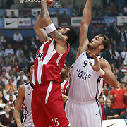 Olympiacos's Georgios Printezis (L) and Anadolu Efes's Semih Erden (R) during their Turkish Airlines Euroleague Basketball playoffs Game 5 Olympiacos between Anadolu Efes at SEF Indoor Hall in Piraeus, in Greece, Friday, April 26, 2013. Photo by TURKPIX