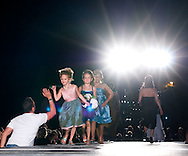 Omaha, NEB 9/19/09.A man gives a high five to some of the child model's wearing Sabrina Jones designed pieces...Chris Machian/The World-Herald