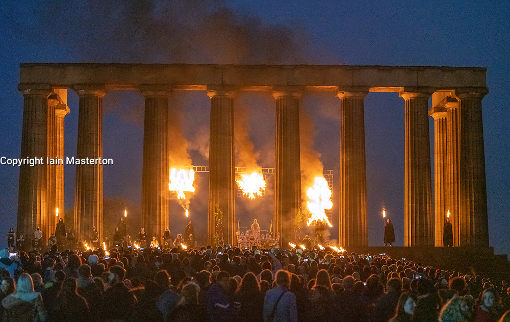 """Edinburgh, Scotland, UK. 30 April, 2019. Beltane Fire Festival ushers in summer on Tuesday 30th April with a spectacular display of fire, immersive theatre, drumming, body paint, and elaborate costumes. Described by some as the """"medieval Burning Man"""", this alternative May Day celebration re-imagines the ancient Celtic festival with roughly 300 volunteer performers for thousands of spectators from all over the world on top of Calton Hill in Edinburgh . Pictured The May Queen on the National Monument<br /> <br /> <br /> WHEN"""