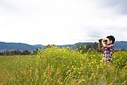 Young boy bird watching in Montana.