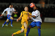 Newport's Conor Washington (l) is challenged by Braintree's Ryan Peters. FA cup with Budweiser, 1st round replay, Newport county v Braintree Town at Rodney Parade in Newport, South Wales on Tuesday 19th November 2013. pic by Andrew Orchard, Andrew Orchard sports photography,