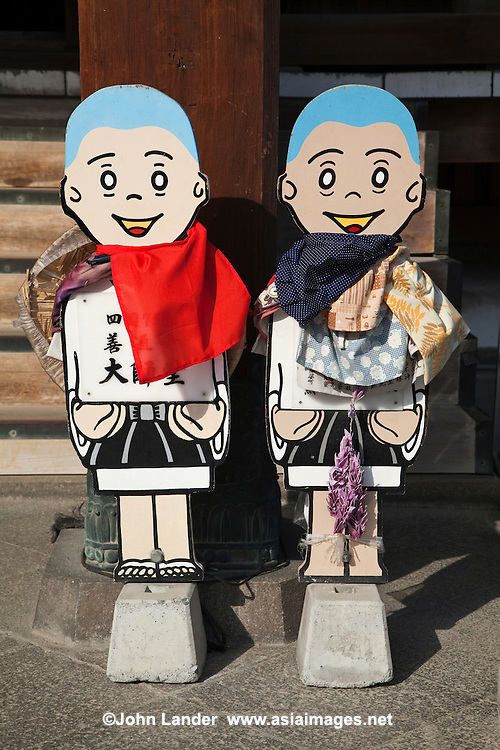 """Henro Japanese Pilgrim Cutouts - The Shikoku Pilgrimage is a trail of 88 temples on the island of Shikoku. It is believed all 88 temples were visited by the famous Buddhist monk Kukai, founder of the Shingon school, who was born in Zentsuji Temple in 774. To complete the pilgrimage, it is not necessary to visit the temples in order. The pilgrimage is traditionally completed on foot, but modern pilgrims use cars, taxis, buses, bicycles or motorcycles. The walking course is approximately 1200km long and can take anywhere from 30 to 60 days to complete. """"Henro"""" is the Japanese word for pilgrim - they are recognizable by their white clothing, sedge hats, and walking sticks."""