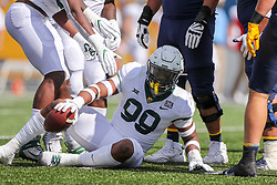 Oct 3, 2020; Morgantown, West Virginia, USA; West Virginia Mountaineers quarterback Jarret Doege (2) fumbles the ball and is recovered by Baylor Bears linebacker William Bradley-King (99) during the first quarter at Mountaineer Field at Milan Puskar Stadium. Mandatory Credit: Ben Queen-USA TODAY Sports