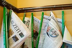 Detail of newspaper rack in famous Cafe Einstein on Unter den Linden in Berlin Germany