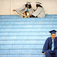 052413       Adron Gardner/Independent<br /> <br /> Window Rock Scout Dennison Segay, right, camps out on the field house bleachers hours before making the walk for graduation in Fort Defiance Friday.