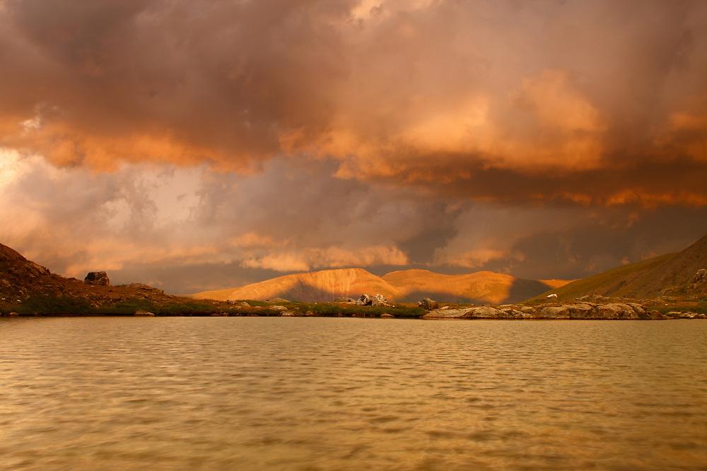 ALPINE TARN AND SUNSET LIGHT ON THUNDERSTORM, MOHAWK VALLEY, TEN MILE RANGE, COLORADO