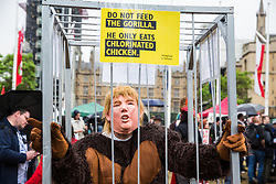 London, UK. 4 June, 2019. An activist disguised as President Trump in the form of a gorilla joins a protest by thousands of climate change activists, women's groups, students, pacifists, trade union members and families against the state visit of US President Donald Trump on the second day of his three day visit. A large policing operation was in place to facilitate the protest but to prevent access to areas immediately adjacent to Downing Street, where talks were taking place between Prime Minister Theresa May and President Trump.