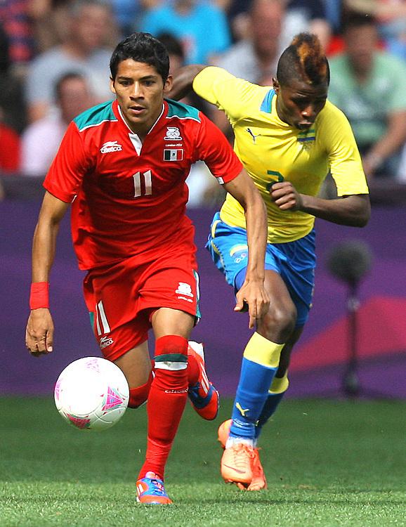 Mexico's Javier AQUINO shields the ball from Gabon's Muller DINDA ..2012 London Olympics - Football - Group B - Mexico v Gabon - Sunday 29th July 2012 - City of Coventry Stadium - Coventry ..