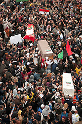 © under license to London News Pictures. 25/02/2011. The coffins of three people who were killed last week during the fighing in Benghazi, Libya are carried to the burial site after midday Friday prayers. Photo credit should read Michael Graae/London News Pictures