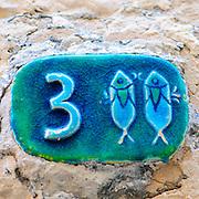 Israel, Jaffa, Ceramic Pisces Zodiac street sign