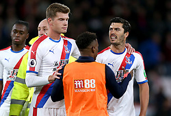 Crystal Palace's James Tomkins (right) continues to argue with Bournemouth's Steve Cook (not in frame) after full time