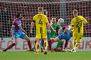 Scunthorpe United goalkeeper Jak Alnwick saves a shot at goal from Burton Albion forward Liam Boyce during the The FA Cup 1st round match between Scunthorpe United and Burton Albion at Glanford Park, Scunthorpe, England on 10 November 2018.