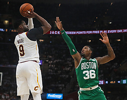 October 17, 2017 - Cleveland, OH, USA - The Cleveland Cavaliers' Dwyane Wade (9) puts up a shot on the Boston Celtics' Marcus Smart (36) in the first quarter on Tuesday, Oct. 17, 2017, at Quicken Loans Arena in Cleveland. (Credit Image: © Leah Klafczynski/TNS via ZUMA Wire)