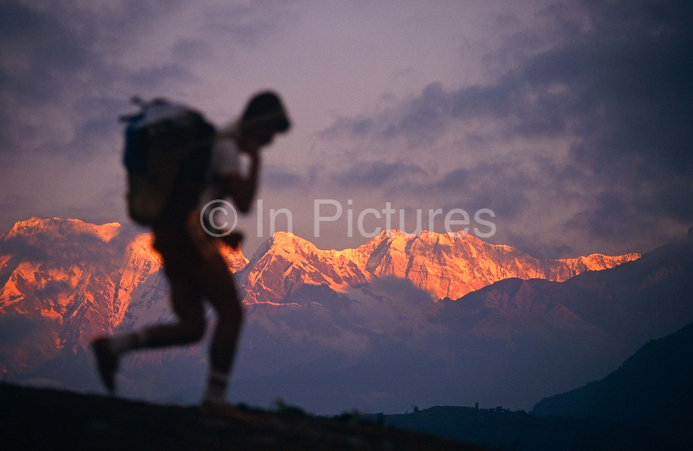 A young Nepali boy is undergoing a recruitment test for the Gurkha Regiment called the Doko race, part of a tough endurance series to find physically perfect specimens for British army infantry training. He has to carry 30kg of river stones in a traditional Himalayan doko (basket) for 3km up foothills within 37 minutes to pass.  60,000 boys aged between 17-22 (or 25 for those educated enough to become clerks or communications specialists) report to designated recruiting stations in the hills each November, most living from altitudes ranging from 4,000-12,000 feet. After initial selection, 7,000 are accepted for further tests from which 700 are sent down here to Pokhara in the shadow of the Himalayas. Only 160 of the best boys succeed in the journey to the UK. The Gurkhas have been supplying youth for the British army since the Indian Mutiny of 1857.