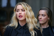 """American actress and model Amber Heard gives a statement in front of the Royal Courts of Justice in central London on Tuesday, July 28, 2020.<br /> An article in the Sun describing Johnny Depp as a """"wife-beater"""" was """"one-sided"""" and """"not researched at all"""", the actor's lawyer told the High Court. In closing submissions for Mr Depp, David Sherborne said the paper acted as """"both judge and jury"""". Mr Depp is suing the newspaper's publisher and editor for libel, saying the allegation is """"completely untrue"""". (VXP Stringer)"""