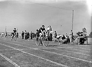 05/07/1952<br /> 07/05/1952<br /> 05 July 1952<br /> N.A.C.A. (National Athletic and Cycling Association) Championship of Ireland Finals at Iveagh Grounds, Crumlin, Dublin. S.B. Donnelly (St. Vincents) winning the 100m cycle. Also pictured is M. Cahill (Harp A.C.) whose chain broke.