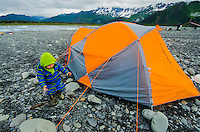 Jordan Forte is bundled up on a rainy morning at Bear Lake/ Bear Glacier, Alaska.