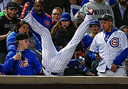 hicago Cubs second baseman Javier Baez (9) crashes into the seats after making a catch for an out on a ball hit by Philadelphia Phillies center fielder Odubel Herrera (37) during the ninth inning at Wrigley Field. Jim Young-USA TODAY Sports