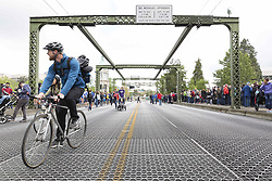May 6, 2017 - Seattle, Washington, United States - Seattle, Washington: Spectators gathered on the Montlake Bridge to view racing shells in the Windermere Cup Crew Racing during Opening Day of Boating Season. (Credit Image: © Paul Gordon via ZUMA Wire)