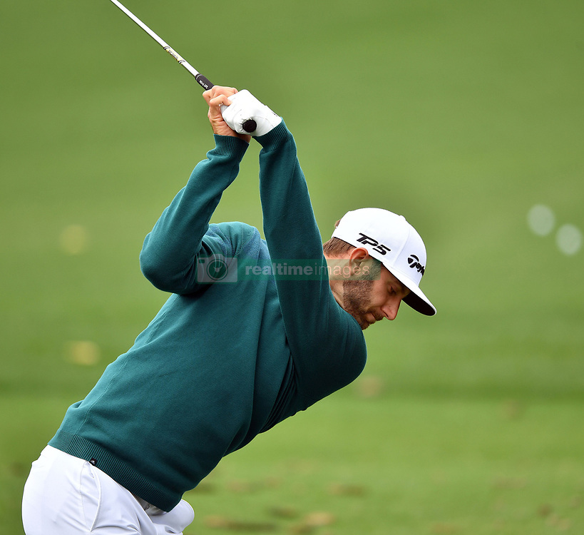 Dustin Johnson hits on the practice range as play begins in the opening round of the 81st Masters tournament at the Augusta National Golf Club, Thursday April 6, 2017 in Augusta, Ga. Johnson was reportedly injured on Wednesday afternoon and his playing status was unclear on Thursday approaching his 2:03 tee time. (Photo by Brant Sanderlin/Atlanta Journal-Constitution/TNS)  *** Please Use Credit from Credit Field ***