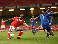 Photo: Rich Eaton.<br /> <br /> Wales v Cyprus. UEFA European Championships 2008 Qualifying. 11/10/2006. Robert Eanrshaw tries a shot on goal in the first half for Wales as Lambros Lambrou tries to block