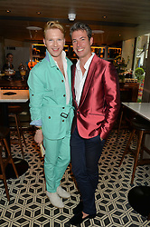 Left to right, HENRY CONWAY and BEN WEST at Henry Conway's 31st birthday party held at the Pont St Restaurant, Belgraves Hotel, London on 12th July 2014.