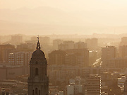 The spire of Malaga Catherdral overlooks the rest of the city, at dusk in Malaga, Spain