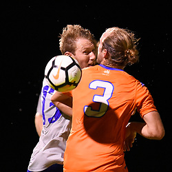 BRISBANE, AUSTRALIA - JANUARY 27: Sam Knight of the Strikers and Jacob Alexander of Lions compete for a headed ball during the Kappa Silver Boot Grand Final match between Lions FC and Brisbane Strikers on January 27, 2018 in Brisbane, Australia. (Photo by Patrick Kearney)