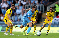 Coventry City's Tom Bayliss (centre) in action