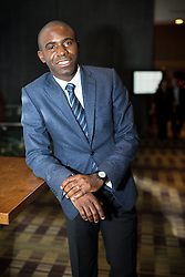 © Licensed to London News Pictures . 09/11/2013 . Manchester , UK . Ex Bolton Wonderers footballer , Fabrice Muamba . Hearts and Minds charity ball in aid of children with autism , this evening (9th November 2013) at the Hilton Hotel on Deansgate in Manchester . Photo credit : Joel Goodman/LNP
