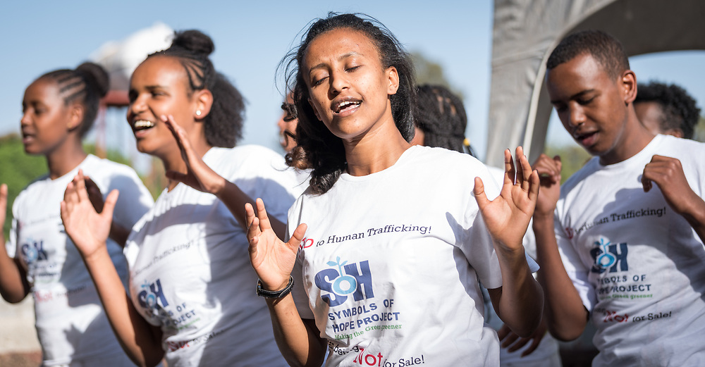 """3 February 2019, Bishoftu, Ethiopia: The Ethiopian Evangelical Church Mekane Yesus' Development and Social Services Commission (EECMY-DASSC) is opening a training centre in Bishoftu, Oromia regional state, Ethiopia, aimed at helping young people to make a sustainable living, even with limited means. Here, a group of youth perform as the Bishoftu Integrated Aquaculture Vocational and Entrepreneurship Training Centre is inaugurated, taking a stand against human trafficking, and the poverty that often fuels it: """"Human beings – Not for Sale!"""""""