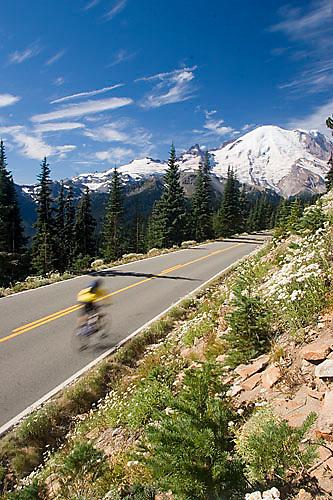 Young man cycling in Mount Rainier National Park, WA.