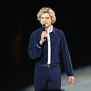 Olympic Gold medalist Charlie White speaks to the crowd during the Stars on Ice Figure Skating tour stop at the Amway Center on Sunday, April 6, 2014 in Orlando, Florida. (AP Photo/Alex Menendez)