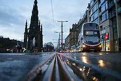 Edinburgh, Scotland, UK. 5 January 2020. Views of a virtually deserted Edinburgh City Centre as Scotland wakes up to the first day of a new strict national lockdown announced by Scottish Government to contain new upsurge in Covid-19 infections. Pic; Princes Street is very quiet.  Iain Masterton/Alamy Live News