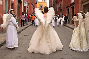 07 APRIL 2004 - SAN MIGUEL DE ALLENDE, GUANAJUATO, MEXICO: Women dressed as angels participate in a Holy Wednesday Stations of the Cross procession through San Miguel de Allende, GTO, MEX. Semana Santa, the week before Easter is celebrated with extreme piety in central Mexico. San Miguel, which was founded in the 1600s, is one of Mexico's premier colonial cities. It has very strict zoning and building codes meant to preserve the historic nature of the city center. About 7,500 US citizens, mostly retirees, live in San Miguel. PHOTO BY JACK KURTZ