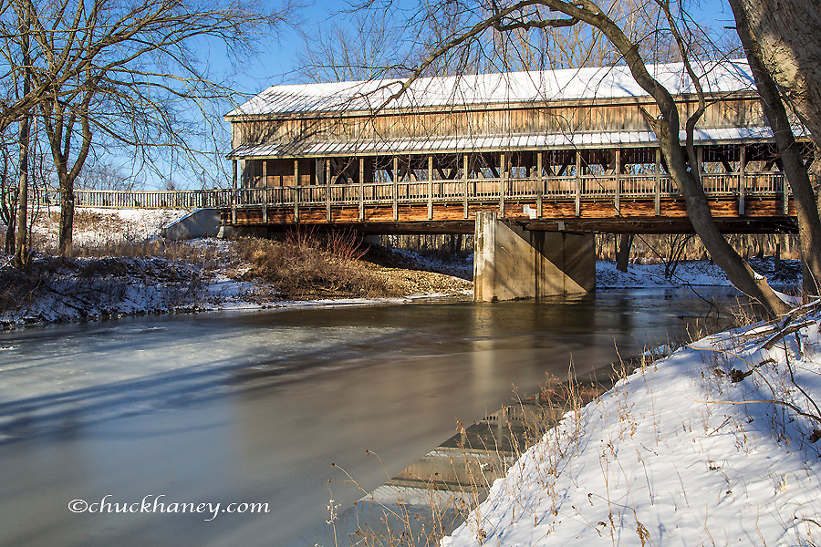 The Lockport Covered Bridge spans the Tiffin River in winter near Stryker, Ohio, USA