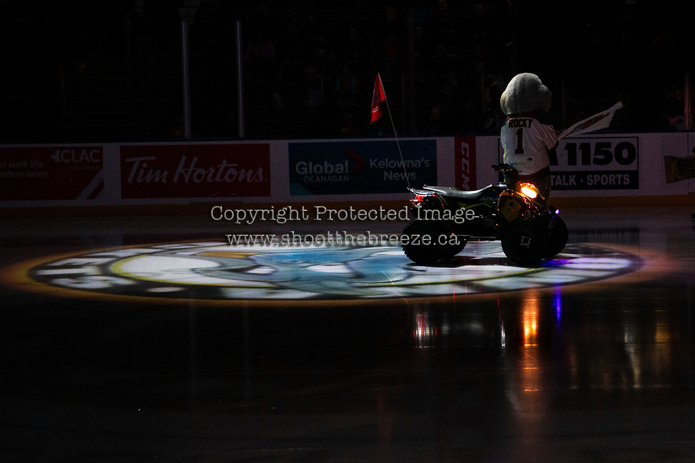 KELOWNA, CANADA - JANUARY 26: Rocky Raccoon, the mascot of the Kelowna Rockets stands on the ice at the start of the game against the Vancouver Giants on January 26, 2019 at Prospera Place in Kelowna, British Columbia, Canada.  (Photo by Marissa Baecker/Shoot the Breeze)