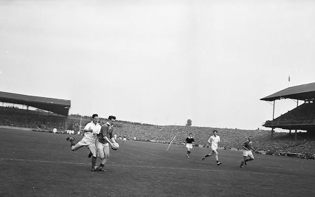 Kerry minor Captain S. O'Mahoney in full flight with the ball closely tackled by Mayo defender D'O'leary at the All Ireland Minor Gaelic Football Final Kerry v Mayo in Croke Park on the 23rd September 1962. Referee: E. Moules (Wicklow) Attendance: 75,771.
