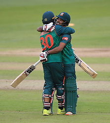Bangladesh's Mosaddek Hossain (right) and Mahmudullah celebrate after winning the ICC Champions Trophy, Group A match at Sophia Gardens, Cardiff.