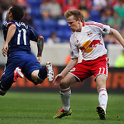 Daniel Paladini, Chicago Fire, (left) is fouled by Dax McCarty, New York Red Bulls, during the New York Red Bulls V Chicago Fire Major League Soccer regular season match at Red Bull Arena, Harrison. New Jersey. USA. 6th October 2012. Photo Tim Clayton