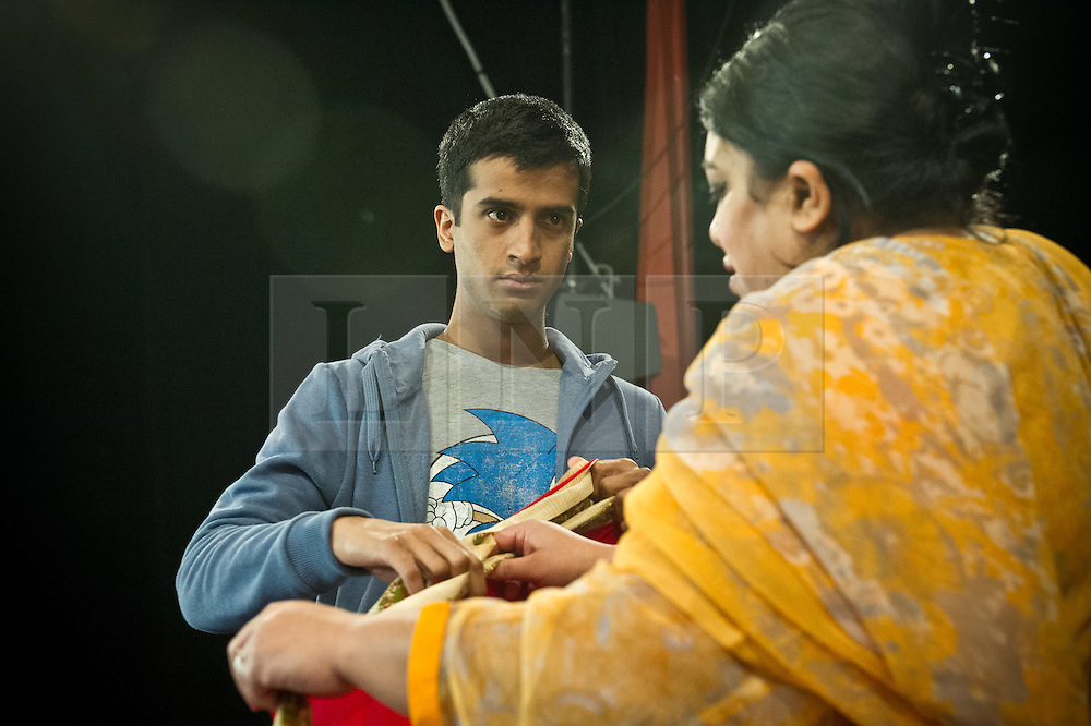 © Licensed to London News Pictures. 27/01/2012. Brolly Productions presents the world premiere of Guantanamo Boy at Stratford Circus. Guantanamo Boy is the stage adaptation of Anna Perera's critically-acclaimed teen novel about a British boy who is kidnapped in the aftermath of 9/11 while on holiday in Pakistan and held in Guantanamo Bay. Picture shows Hamza Jeetooa as Kalid and Rina Fatania as mother.  Photo credit : Tony Nandi/LNP