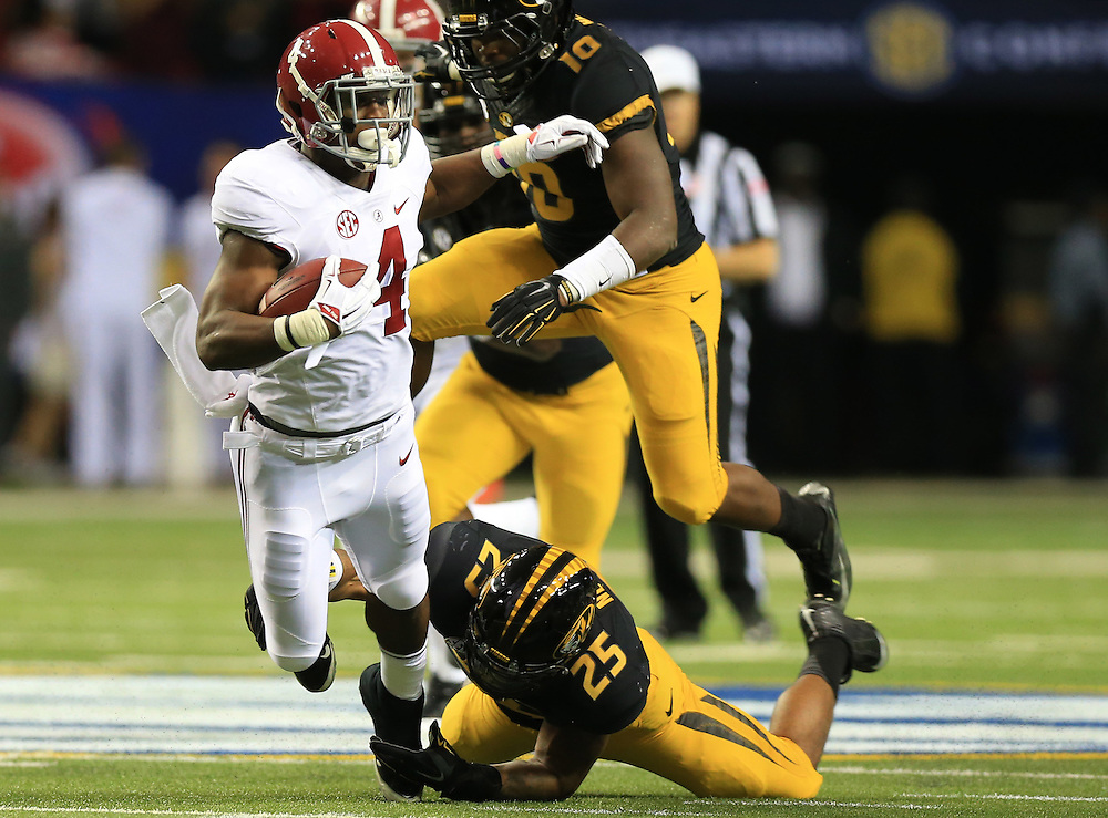 Dec 6, 2014; Atlanta, GA, USA; Alabama Crimson Tide running back T.J. Yeldon (4) is brought down by Missouri Tigers linebacker Donavin Newsom (25) during the first quarter of the 2014 SEC Championship Game at the Georgia Dome. Mandatory Credit: Kevin Liles-USA TODAY Sports