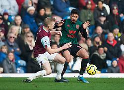 Ben Mee of Burnley (L) and Mahmoud Hassan of Aston Villa in action - Mandatory by-line: Jack Phillips/JMP - 01/01/2020 - FOOTBALL - Turf Moor - Burnley, England - Burnley v Aston Villa - English Premier League