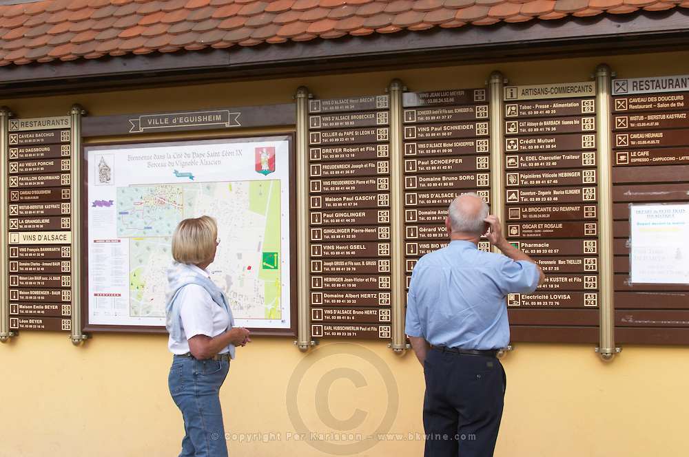 a couple reading signs eguisheim alsace france