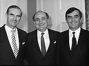 New Fianna Fáil Administration Sworn In.  (R52)..1987..10.03.1987..03.10.1987..10th March 1987..After their win in the recent general election the new Fianna Fáil government,under the leadershio of Charles Haughey, was sworn in and given their seals of offce at a ceremony in Áras an Uachtaráin today. The government received their seals from President Patrick Hillery...Picture shows three Limerick men in the new cabinet, Michael Noonan, Gerry Collins and John Murray, Attorney General.