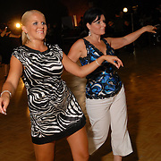 Same-sex dancers Lorraine Vickers, left, and her mother, Sharon Vickers, dance together at the Grand Ball, a party following the same-sex ballroom dancing competition at the 2007 Eurogames, both held at the Waagnatie hangar in Antwerp, Belgium on July 14, 2007. ..The women both compete with different partners. ..Over 3,000 LGBT athletes competed in 11 sports, including same-sex dance, during the 11th annual European gay sporting event. Same-sex ballroom is a growing sports that has been happening in Europe for over two decades.