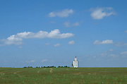 crop land with a silo in the distance USA