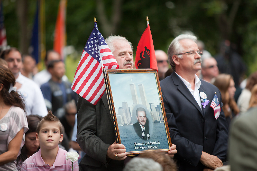 Man with a picture of a loved one killed on 9/11 at a memorial held on the 10 Year Anniversary of 9/11 at the Rising, a memorial located in the Kensico Dam Plaza of Valhalla, Westchester County, New York, created by architect Frederic Schwartz commemorating the victims of 9/11 from Westchester County.