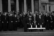 Acting Commissioner of the Metropolitan Police Craig Mackey, Home Secretary Amber Rudd and the Mayor of London Sadiq Khan, light candles  during a candlelit vigil at Trafalgar Square.  in London, England. Four people were killed in the previous day  by Khalid Masood. March 23 2017
